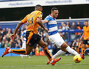 Queens Park Rangers midfielder Matt Phillips looks to keep the ball on the edge of the box despite Wolverhampton Wanderers defender Ethan Ebanks-Landell closing him down during the Sky Bet Championship match between Queens Park Rangers and Wolverhampton Wanderers at the Loftus Road Stadium, London, England on 23 January 2016. Photo by Andy Walter.