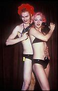 Clubbing couple in bikinis with guns, Ibiza 1998