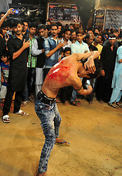 October 28, 2016 - Allahabad, Uttar Pradesh, India - Allahabad: A Shia Muslim devotee hit himself by a bunch of knief  during take part in Ashura'a Taziya parade held in Allahabad on 28-10-2016, Muharram is celebrated to mark the climax of the mourning which is Called Ashura, The ccommenmoration of Imam Hussain's. photo by prabhat kumar verma (Credit Image: © Prabhat Kumar Verma via ZUMA Wire)