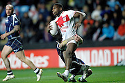 England's Jermaine McGillvary (2 Huddersfield Giants) is tackled by Danny Brough (6 Huddersfield Giants) during the Ladbrokes Four Nations match between England and Scotland at the Ricoh Arena, Coventry, England on 5 November 2016. Photo by Craig Galloway.