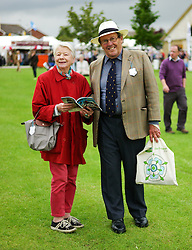 © Licensed to London News Pictures.14/07/15<br /> Harrogate, UK. <br /> <br /> A couple react to the camera as they visit on the opening day of the Great Yorkshire Show.  <br /> <br /> England's premier agricultural show opened it's gates today for the start of three days of showcasing the best in British farming and the countryside.<br /> <br /> The event, which attracts over 130,000 visitors each year displays the cream of the country's livestock and offers numerous displays and events giving the chance for visitors to see many different countryside activities.<br /> <br /> Photo credit : Ian Forsyth/LNP