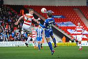 Doncaster Rovers No 7 Gary McSheffrey And Wigan No 22 Stephen Warnock In Action during the Sky Bet League 1 match between Doncaster Rovers and Wigan Athletic at the Keepmoat Stadium, Doncaster, England on 16 April 2016. Photo by Stephen Connor.