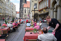 Busy street cafe  on Prinzipalmarkt in central Munster  Germany