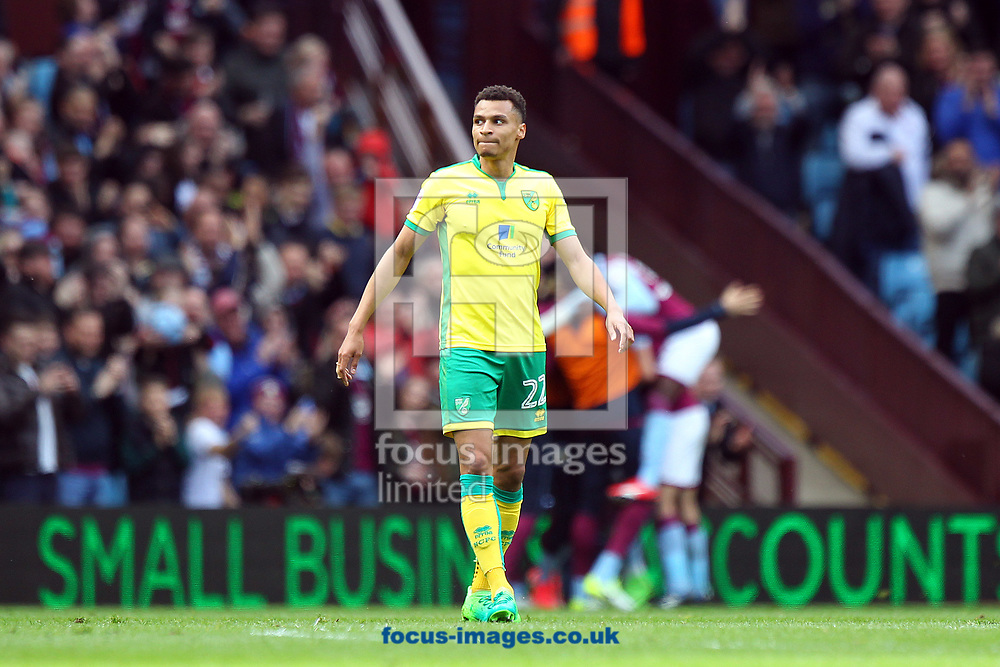 Jacob Murphy of Norwich looks dejected as the Aston Villa players celebrate their side&rsquo;s 1st goal during the Sky Bet Championship match at Villa Park, Birmingham<br /> Picture by Paul Chesterton/Focus Images Ltd +44 7904 640267<br /> 01/04/2017