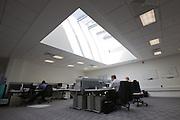 Sunlight streams through skylight in office