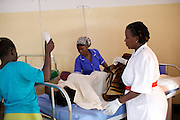 Sister Mampewo Sarah Senkungi looks after a patient after her operation at Kasangati Health Centre in Uganda.
