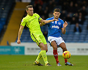 Hartlepool United Defender Carl Magnay callenges Portsmouth striker Gareth Evans during the Sky Bet League 2 match between Portsmouth and Hartlepool United at Fratton Park, Portsmouth, England on 12 December 2015. Photo by Adam Rivers.