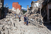 24 August 2016, Amatrice Italy - A old woman accompanied by a man between the rubble after a 6.3 earthquake hit the town of Amatrice in Lazio region killing more than 240 people. Many other towns of the italian central regions have been hit by the quake. There are still many missing people under the rubble.