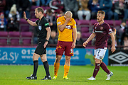 Curtis Main (#9) of Motherwell FC holds his head in his hands after referee William Collum gives a foul against him during the Ladbrokes Scottish Premiership match between Heart of Midlothian and Motherwell at Tynecastle Stadium, Edinburgh, Scotland on 8 December 2018.