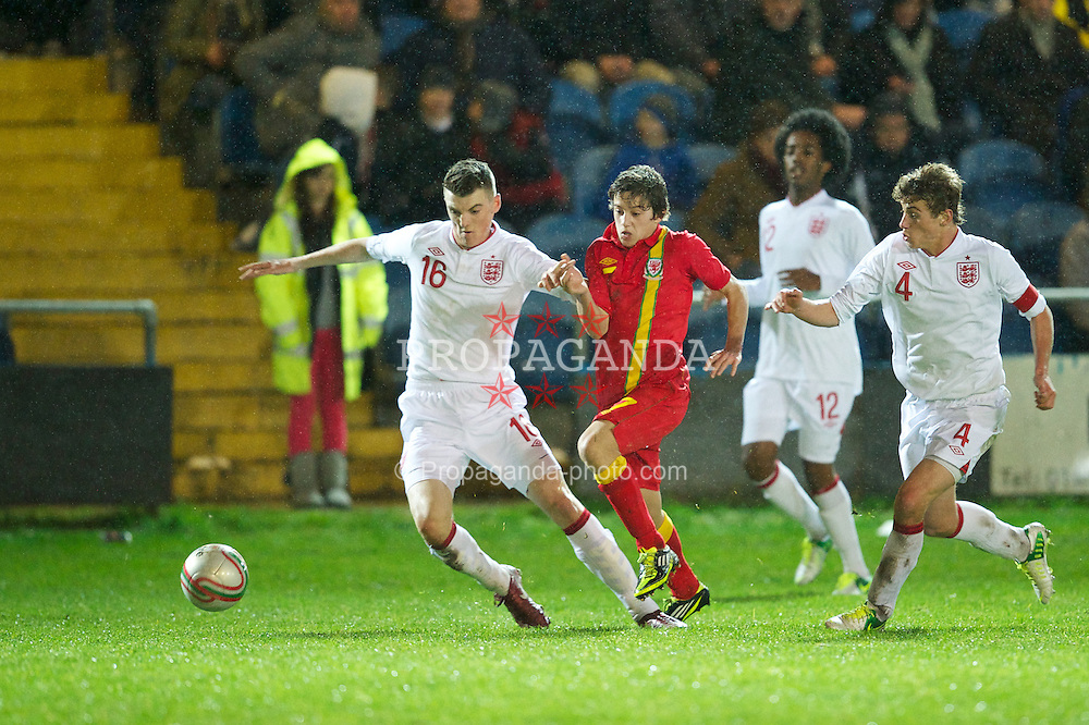 PORT TALBOT, WALES - Thursday, November 1, 2012: Wales' Daniel James is muscled out by England's Kyle Cameron and captain Ryan Ledson during the Under-16's Victory Shield match at Victoria Road. (Pic by David Rawcliffe/Propaganda)