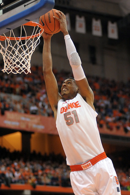 Syracuse Orange center Fab Melo (51) goes up for the dunk in the second half against the Providence Friars at the Carrier Dome in Syracuse, NY.  The top ranked Syracuse Orange defeated Providence Friars 78-55.