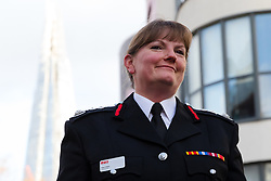 © Licensed to London News Pictures. 23/12/2019. London, UK. London Fire Commissioner (LFC), Dany Cotton smiles after making a speech from a vintage fire engine after being greeted by members and family of the Fire Brigade on her final day in office. Hundreds of firefighters lined Union Street in London today to provide a Guard of Honour on the final day in office for London Fire Commissioner, Danny Cotton. Photo credit: Vickie Flores/LNP