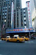 Yellow Cab taxis pass Radio City Music Hall, Manhattan, New York