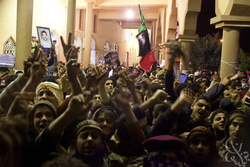 Libyan youths chant anti-government slogans during nighttime protests in Tobrouk, Libya February 22, 2011. Protests that began in Libya February 17 have spread across the country and threaten to bring down the 42 year regime of Libyan leader Col. Qaddafi. .Slug: Libya.Credit: Scott Nelson for the New York Times