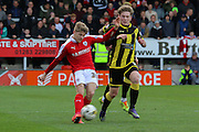 Barnsley midfielder Lloyd Isgrove strikes the ball during the Sky Bet League 1 match between Burton Albion and Barnsley at the Pirelli Stadium, Burton upon Trent, England on 16 April 2016. Photo by Aaron  Lupton.