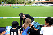 Henry Nichols of the Black Caps signs autographs during the ANZ One Day International match between the Black Caps and Bangladesh, played at the University Oval, Dunedin, New Zealand, on February 20, 2019. Copyright Image: Joe Allison / www.Photosport.nz