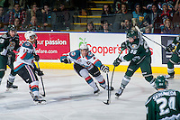 KELOWNA, CANADA - JANUARY 23: Madison Bowey #4 of Kelowna Rockets stick checks Nikita Scherbak #95 of Everett Silvertips as he takes a shot on net on January 23, 2015 at Prospera Place in Kelowna, British Columbia, Canada.  (Photo by Marissa Baecker/Shoot the Breeze)  *** Local Caption *** Madison Bowey; Nikita Scherbak;