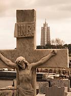 Monument to Jose Marti (background) and crucifixion statue at Cementerio de Colon, Havana, Cuba