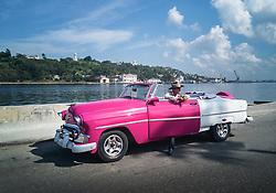 Vintage cars in Havana Malecon, Cuba.