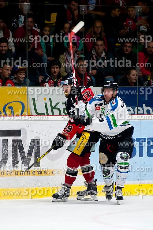 04.10.2015, Ice Rink, Znojmo, CZE, EBEL, HC Orli Znojmo vs HDD TELEMACH Olimpija Ljubljana, 8. Runde, im Bild v.l. Jan Lattner (HC Orli Znojmo) Anze Ropret (HDD TELEMACH Olimpija Ljubljana) // during the Erste Bank Icehockey League 8th round match between HC Orli Znojmo and Moser Medical Graz 99ers at the Ice Rink in Znojmo, Czech Republic on 2015/10/04. EXPA Pictures © 2015, PhotoCredit: EXPA/ Rostislav Pfeffer