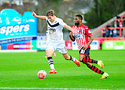 Port Vale's Sam Foley and Exeter City's Joel Grant during the The FA Cup match between Exeter City and Port Vale at St James' Park, Exeter, England on 6 December 2015. Photo by Graham Hunt.