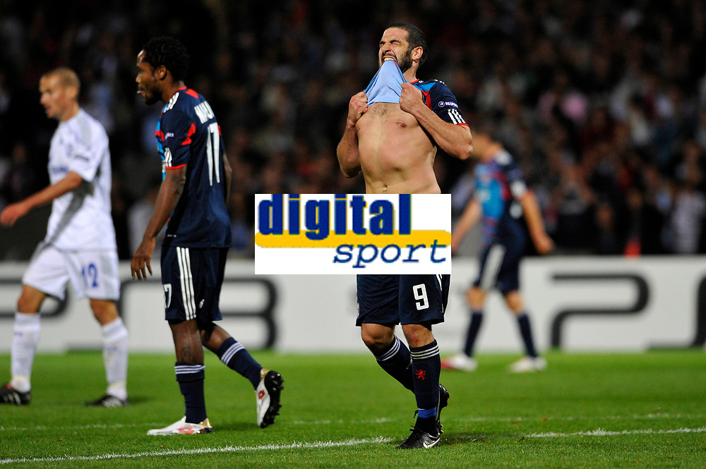 FOOTBALL - CHAMPIONS LEAGUE 2010/2011 - GROUP STAGE - GROUP B - OLYMPIQUE LYONNAIS v SCHALKE 04 - 14/09/2010 - PHOTO GUY JEFFROY / DPPI - DISAPPOINTMENT LISANDRO LOPEZ (LYON)