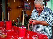 25 AUGUST 2018 - GEORGE TOWN, PENANG, MALAYSIA: A man sets up his family altar on Ghost Day, the full moon day (or night) that falls in the middle of Hungry Ghost month. The Ghost Festival, also known as the Hungry Ghost Festival is a traditional Taoist and Buddhist festival held in Chinese communities throughout Asia. Ghost Day, is on the 15th night of the seventh month (25 August in 2018). During Ghost Festival, the deceased are believed to visit the living. In many Chinese communities, there are Chinese operas and puppet shows and elaborate banquets are staged to appease the ghosts.      PHOTO BY JACK KURTZ