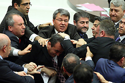 60960507<br /> Members of parliament from the ruling Justice and Development Party (AK Party) and the main opposition Republican People s Party (CHP) scuffle during a debate at a parliamentary session in Ankara, Turkey, on Jan. 23, 2014. CHP deputy Bulent Tezcan received punches to his face three times as AK Party deputy Oktay Saral attacked him afer a brawl on the graft investigation broke out during a parliamentary session Thursday. A CHP deputy was taken to hospital,Turkey, Thursday, 23rd January 2014. Picture by  imago / i-Images<br /> UK ONLY