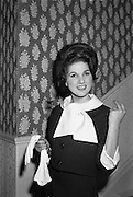 12/09/1962<br /> 09/12/1962<br /> 12 September 1962<br /> Fashion: Veronica Jaye Autumn/Winter collection 1962 fashion show at the Northbrook Hotel, Dublin. Navy will suit with whote linen over/blouse worn by Maida.