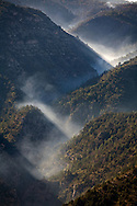 Forest fire smoke from a fire on the rim above filling up a side canyon of Sycamore Canyon