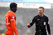 Referee Michael Salisbury has a word with Shrewsbury Town defender Aristote Nsiala (22)  during the EFL Sky Bet League 1 match between Scunthorpe United and Shrewsbury Town at Glanford Park, Scunthorpe, England on 17 March 2018. Picture by Mick Atkins.