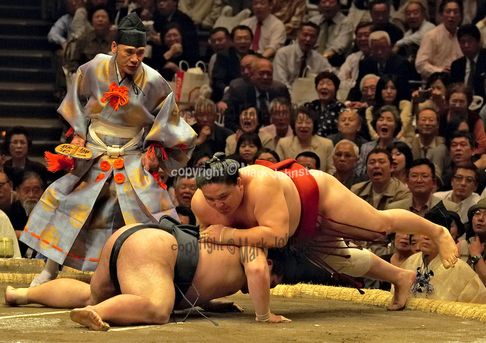 "Action from the Tokyo Spring ""basho"" at Kokugikan."