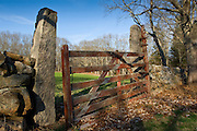 A gate in the stone wall on a private lane on a farm in Wakefield, South Kingstown, Rhode Island.