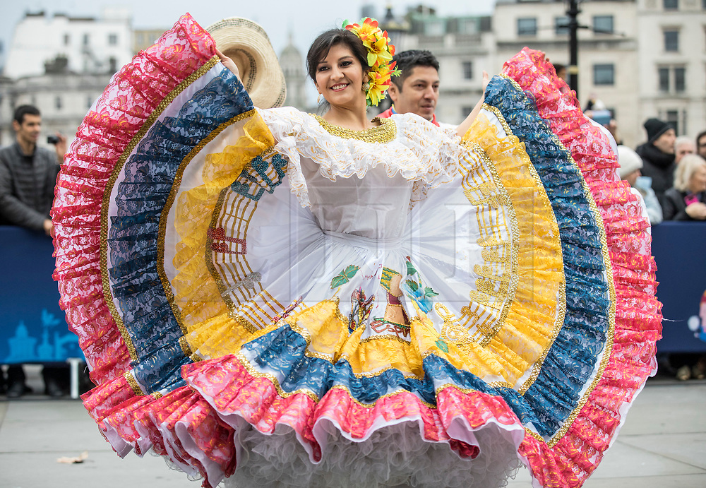 © Licensed to London News Pictures. 30/12/2018. London, UK. A dancer from Carnaval Del Pueblo, a dance group from across Latin America, performs at a preview ahead of the London New Year's Day Parade. More than 8,000 performers from 26 countries will take part in the parade on 1st January 2019. Photo credit: Rob Pinney/LNP