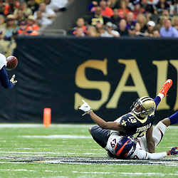 Nov 13, 2016; New Orleans, LA, USA;  Denver Broncos free safety Darian Stewart (26) intercepts a pass that is deflected by New Orleans Saints wide receiver Michael Thomas (13) during the first half of a game at the Mercedes-Benz Superdome. Mandatory Credit: Derick E. Hingle-USA TODAY Sports
