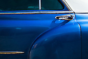 Detail of the door of a 1950s American automobile in Trinidad, Cuba on Thursday July 17, 2008.