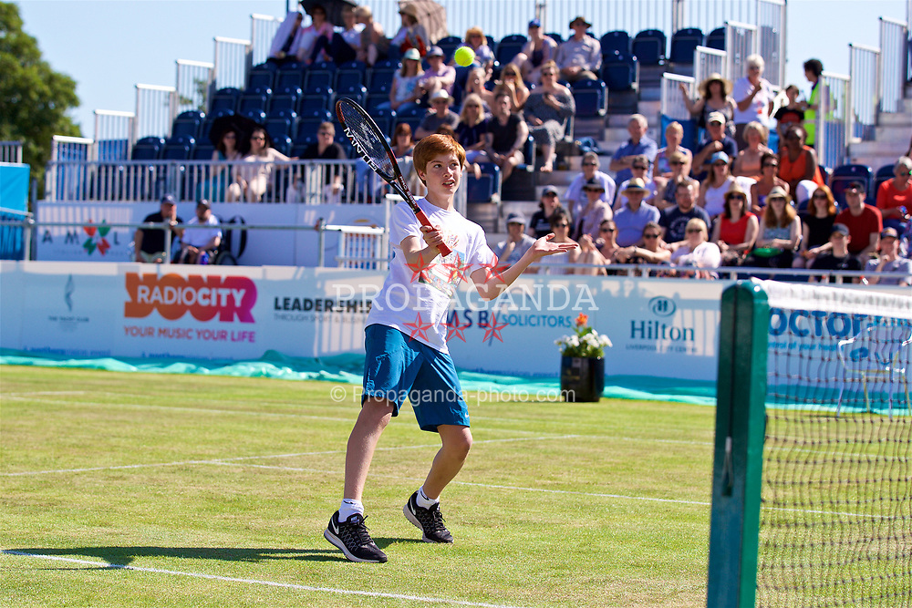 LIVERPOOL, ENGLAND - Saturday, June 17, 2017: A ball boy plays a point during Day Three of the Liverpool Hope University International Tennis Tournament 2017 at the Liverpool Cricket Club. (Pic by David Rawcliffe/Propaganda)