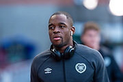 Uche Ikpeazu (#19) of Heart of Midlothian FC arrives before the Ladbrokes Scottish Premiership match between Heart of Midlothian and Rangers FC at Tynecastle Park, Edinburgh, Scotland on 20 October 2019.