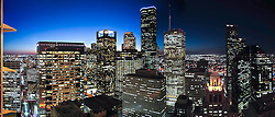 Panoramic view of downtown Houston, Texas skyscrapers showing the night time city lights.