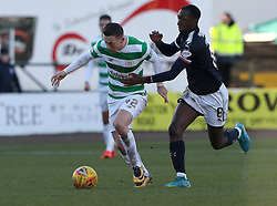 Celtic's Callum McGregor (left) and Dundee Glen Kamara battle for the ball during the Scottish Premiership match at Dens Park, Dundee.