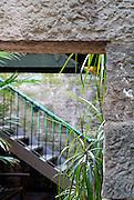 Stairway viewed through doorway in old sandstone wall. The Rocks, Sydney, Australia