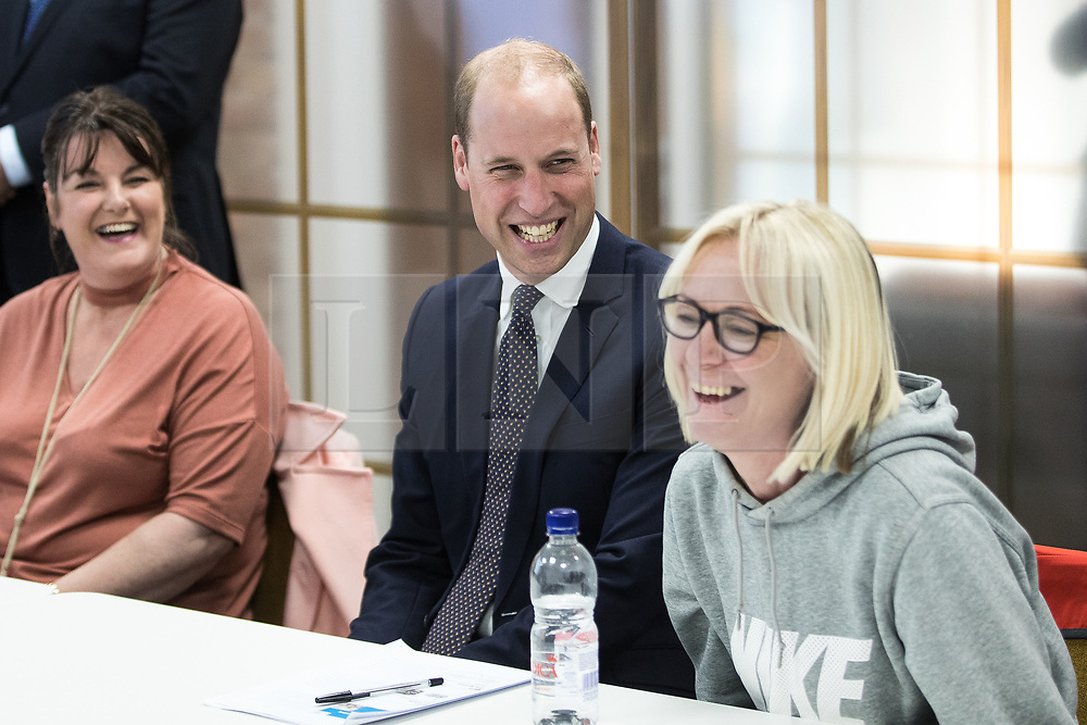 © Licensed to London News Pictures . 14/09/2017 . Liverpool , UK . The Duke of Cambridge , Prince William , sits in on a confidence building session during a visit to Life Rooms in Walton . Life Rooms provides community support to help people recover from mental health issues . Photo credit : Joel Goodman/LNP