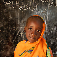 Kubri School , Krindig 1camp.Al Geneina. Darfur.Sudan. September 2007<br /> Kubra Abdullah Aziz Mohammed in front of the blackboard in her classroom.