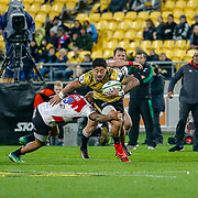 Ben Lam running  during the Super rugby (Round 12) match played between Hurricanes  v Lions, at Westpac Stadium, Wellington, New Zealand, on 5 May 2018.  Hurricanes won 28-19.