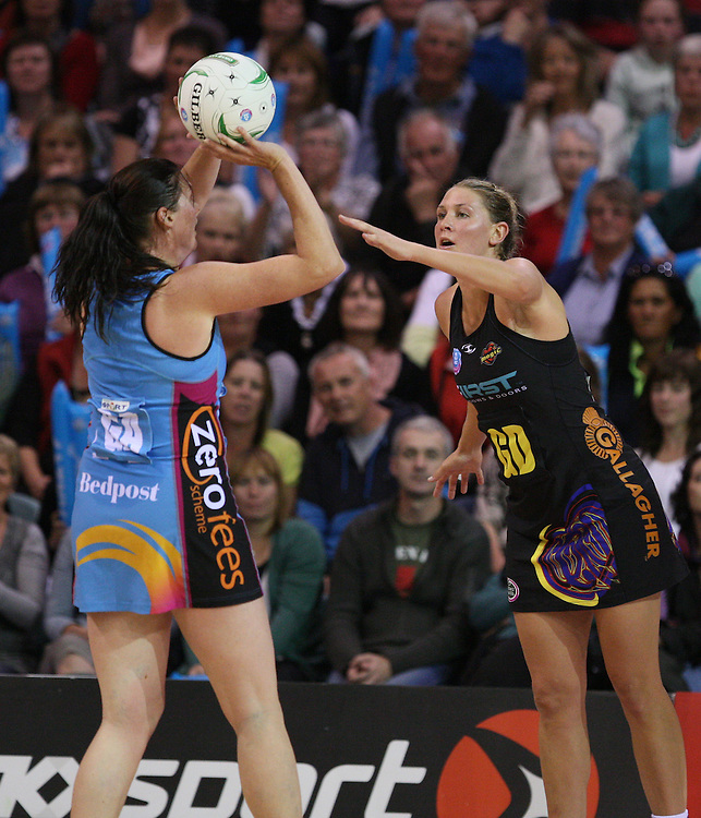 Southern Steel's Donna Wilkins, left, shot at goal is defended by Magic's Casey Williams in the ANZ Netball Championships at Invercargill Velodrome, Invercargill, New Zealand, Monday, April 02, 2012. Credit:SNPA / Dianne Manson