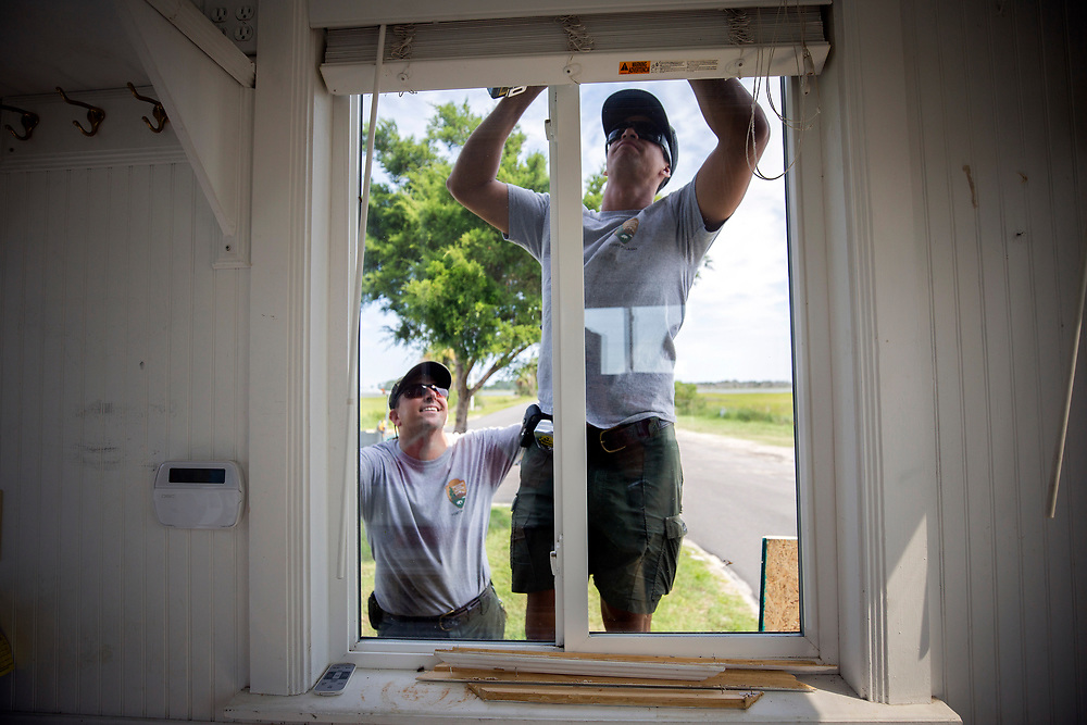 National Park Service employees Joel Cadoff, left, and Miguel Rome, right, secure the windows of the entrance station at Fort Pulaski National Monument near Tybee Island, Ga., Friday, Sept., 8, 2017, before Hurricane Irma is forecast to hit the area early next week. (Stephen B. Morton for The Atlanta Journal Constitution)