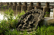 21st August 2014, Yamuna River, New Delhi, India. A bas-relief representation of the Hindu deity Ganesha near a shrine on the banks of the Yamuna River, New Delhi, India on the 21st August 2014. In Hinduism the elephant-headed god Ganesh, the remover of obstacles, is invoked before every new endeavour and is particularly revered by all Hindus. <br />