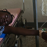Diana Oja receives oxytocin to augment her labor at the Kintampo Municipal Hospital. Diana, who is an Oxytocin Initiative participant, was brought to the hospital by CHO Apoyongo McClean from Kawampe village because she was experiencing a prolonged labor.