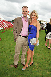 TV presenter LARA LEWINGTON and husband TV money expert MARTIN LEWIS at the 25th annual Cartier International Polo held at Guards Polo Club, Great Windsor Park, Berkshire on 26th July 2009.
