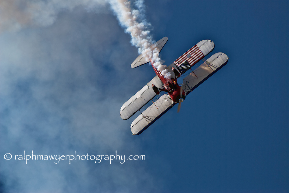 Greg Shelton performing acrobatic maneuvers in his Super Stearman bi-plane at the 8th Annual Moonlight Fund airshow in New Braunfels, Texas, October 20, 2007. Co-founded in 1998 by two burn survivors, Henry F. Coffeen III and Celia Jones, the Moonlight Fund is a Texas based organization providing support services for both civilian and military burn victims and their families.